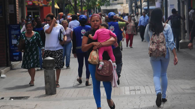 People walking in a street of Honduras.
