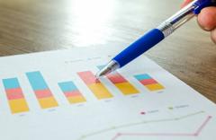 analytics_blur_chart_close_up_commerce_focus_graphs_hand.png