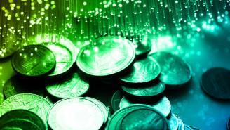Imagen de monedas y fibra óptica